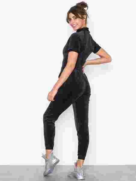 16c626a91e3 Sg X Puma Jumpsuit - Puma - Black - Jumpsuits - Sports Fashion ...