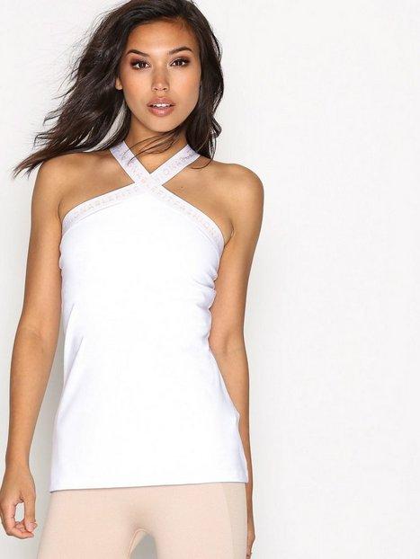 Billede af Fashionablefit Cross Over Front Top Top Indbygget Sports BH Hvid