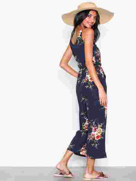 1d7f1b72d43a Less than three in stock. Strappy Floral Jumpsuit. Strappy Floral Jumpsuit. Strappy  Floral Jumpsuit. Strappy Floral Jumpsuit