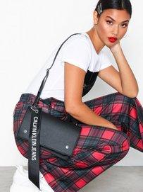 80e95ced59b Logo Banner Shoulder Flap Bag - Calvin Klein - Black - Bags - Accessories -  Women - Nelly.com